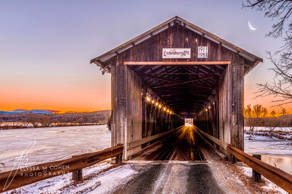 Lunenburg covered bridge stretching over the Connecticut River - These timeless structures are a reminder of when time moved a little bit slower